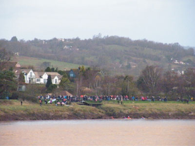 Crowds gather on the riverbank